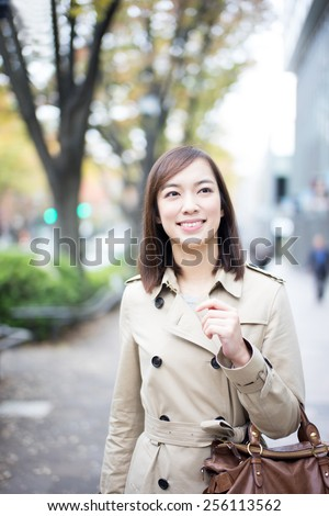 beautiful young woman looking displays in the window  - stock photo