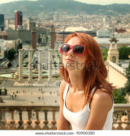 beautiful young woman looking over city - stock photo