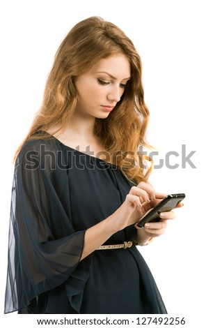 beautiful young woman looks in phone isolated on white background - stock photo