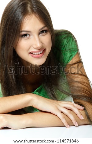 Beautiful young woman lying down and happy smiling. Isolated on white background - stock photo