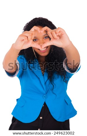 Beautiful young woman making a heart with hands, isolated on white - stock photo