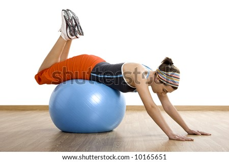 Beautiful young woman making exercises with a core ball