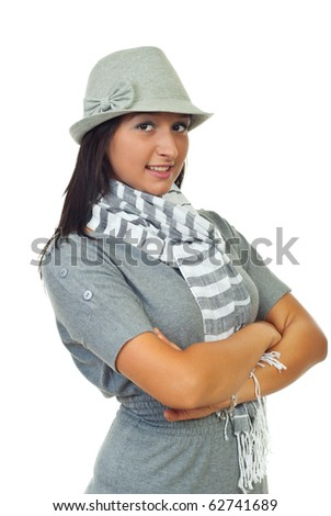 Beautiful young woman model wearing hat and gray clothes standing with arms folded isolated on white background