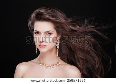 beautiful young woman model with perfect makeup wearing jewelry - stock photo