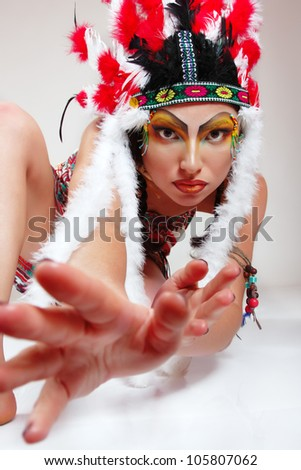 Beautiful young woman native American Indian looking at camera with interest and fear, isolated on white background - stock photo