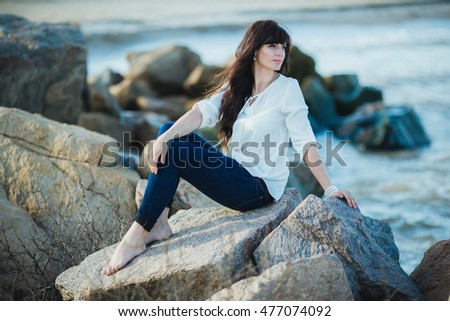 Beautiful young woman on a sea-shore