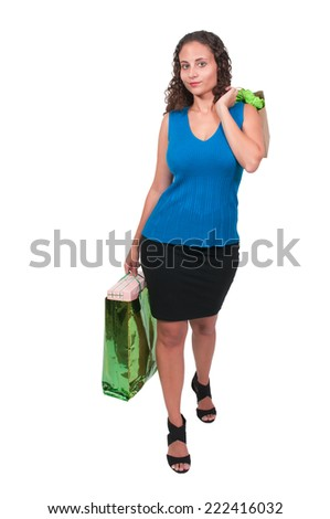 Beautiful young woman on a shopping spree