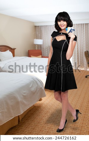 Beautiful young woman on a shopping spree with credit and debit cards - stock photo