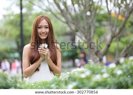 Beautiful young woman on garden. Portrait asian woman in emotion