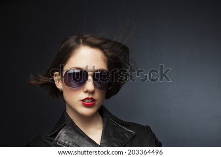 Beautiful young woman on gray background.