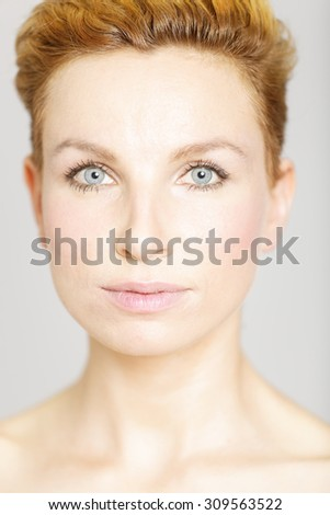 Beautiful young woman on isolated background in a beauty style pose