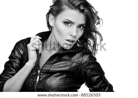 Beautiful young woman on leather jacket. Black-white photo. - stock photo