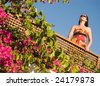 Beautiful young woman on the balcony - stock photo