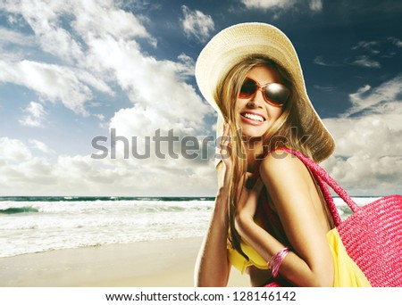 Beautiful young woman on the beach - stock photo