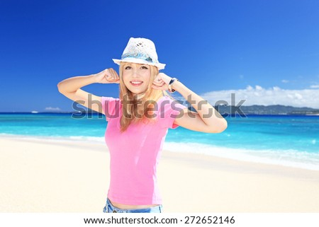 Beautiful young woman on the beach enjoy sunlight  - stock photo