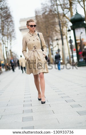 Beautiful young woman on the Champs-Elysees in Paris - stock photo