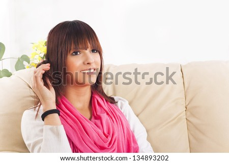 beautiful young woman on the couch - stock photo