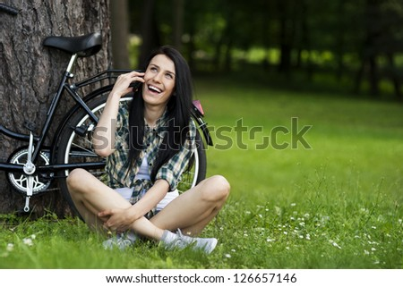 Beautiful young woman on the phone - stock photo
