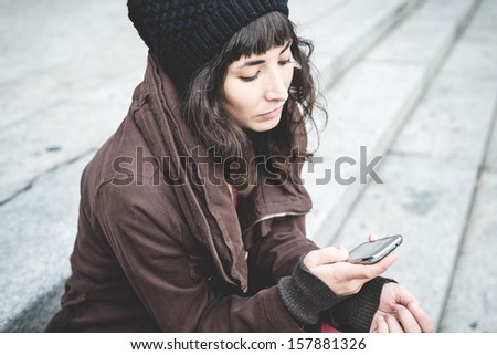 beautiful young woman on the phone in the city autumn