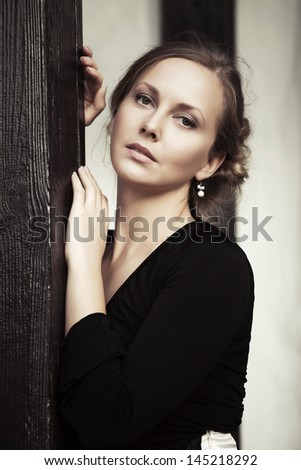 Beautiful young woman on the porch