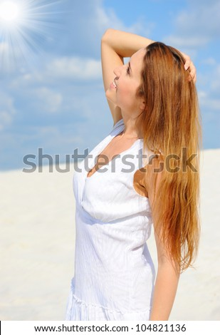 beautiful young woman on the sunny beach