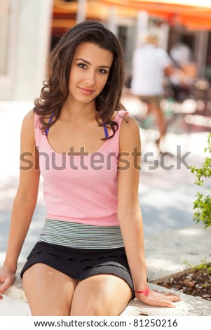 Beautiful young woman outdoor in Miami Beach Lincoln Road Mall. - stock photo