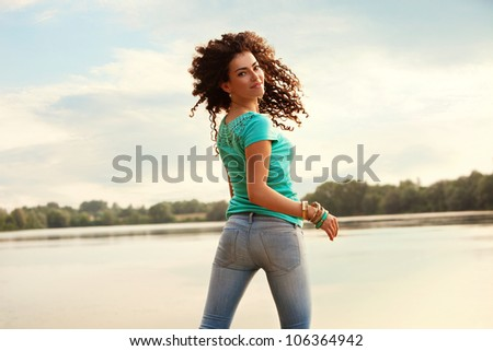 beautiful young woman outdoor portrait at sunset - stock photo