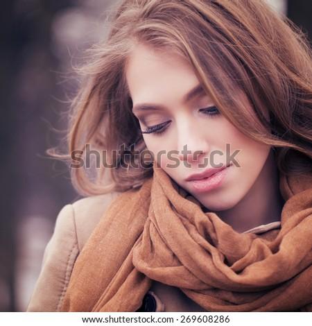 Beautiful young woman outdoors - stock photo