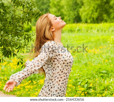 Beautiful Young Woman Outdoors. Enjoy Nature. Beauty Girl Outdoor. Freedom concept. - stock photo