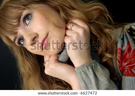 Beautiful young woman over black background