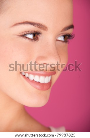 Beautiful young woman. perfect teeth smiling - stock photo