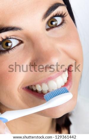 beautiful young woman picking his teeth - stock photo
