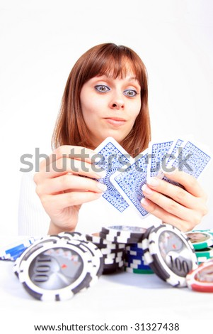 Beautiful Young Woman playing poker - stock photo