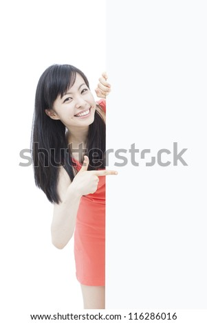 beautiful young woman pointing blank billboard, isolated on white background - stock photo