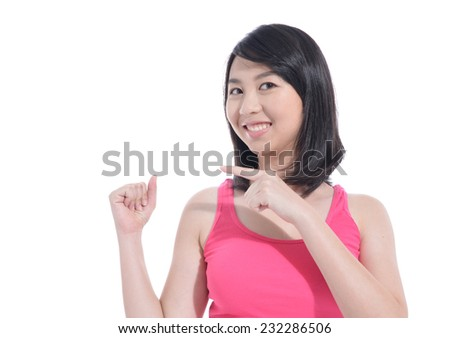 beautiful young woman pointing her finger on white background - stock photo