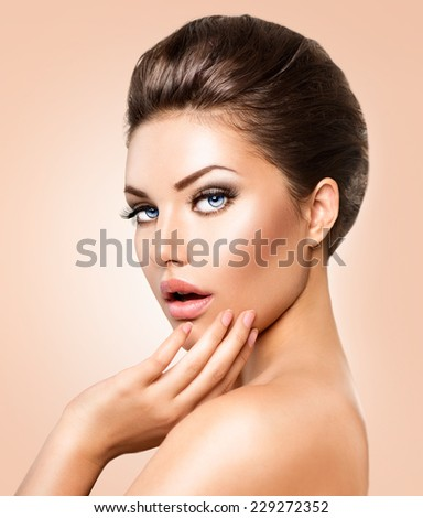Beautiful young woman portrait. Beauty girl face. Perfect skin, skincare. Beautiful Young Woman with Clean Fresh Skin close up. Spa Woman touching her skin. Perfect makeup, make up. - stock photo