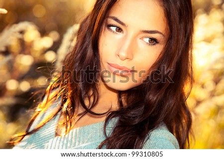 beautiful young woman portrait, close up outdoor