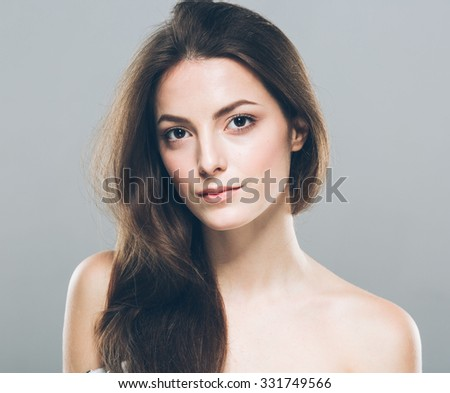 Beautiful young woman portrait cute tender pure smiling posing attractive - stock photo