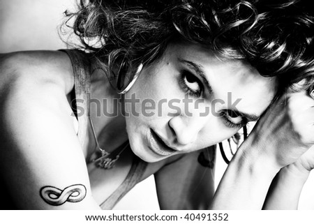 beautiful young woman portrait in black and white, indoor shot - stock photo
