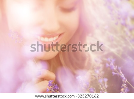 Beautiful young woman portrait in lavender field - stock photo