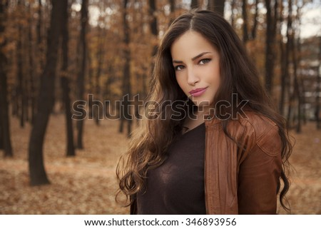beautiful young woman portrait in park, autumn season, outdoor