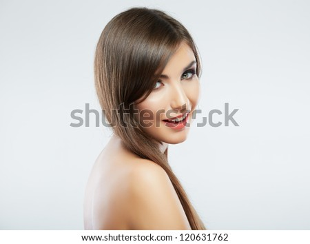 Beautiful young woman portrait isolated on studio background. Close up face. Long hair