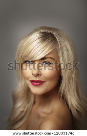beautiful young woman portrait posing in the studio - stock photo