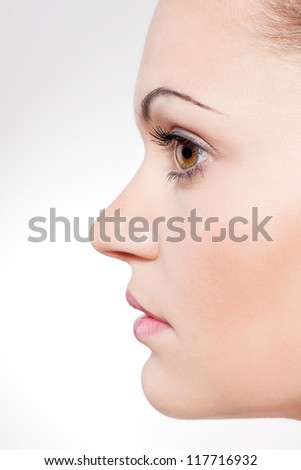 beautiful young woman portrait profile close up - stock photo