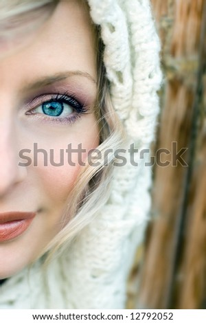 Beautiful young woman portrait with blue eyes and muffler - stock photo