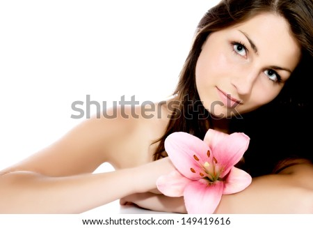 Beautiful young woman portrait with lily flower isolated on white background with copy space   - stock photo