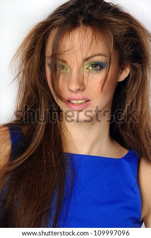 beautiful young woman portrait with long hair in motion - stock photo