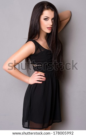 beautiful young woman portrait with long hair, studio shot - stock photo