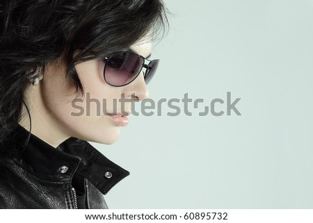 Beautiful young woman portrait with sunglasses - stock photo