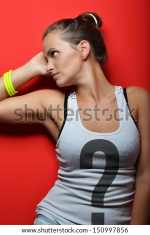 beautiful young woman posing against red background